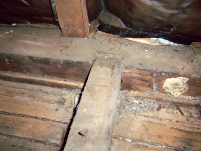 Post and beam framing is exposed in the attic as well and shows the scribe marks that the builder used to match the pre-cut tenons and mortises.