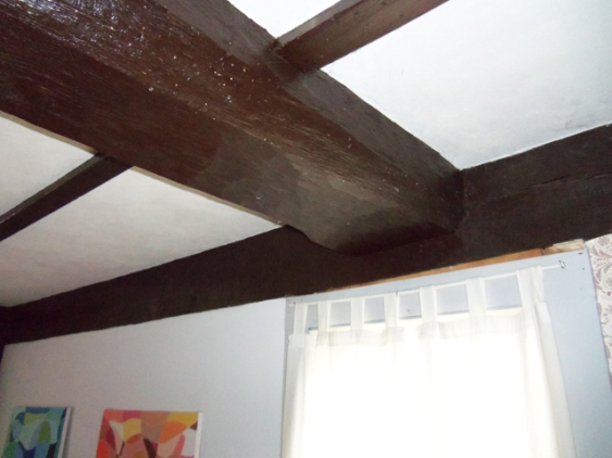 Massive summer beams are exposed throughout the house
