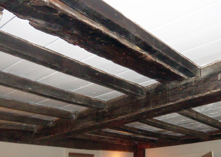 Post and beam construction in the ceiling of the oldest section of the Day-Dodge house, facing East St.