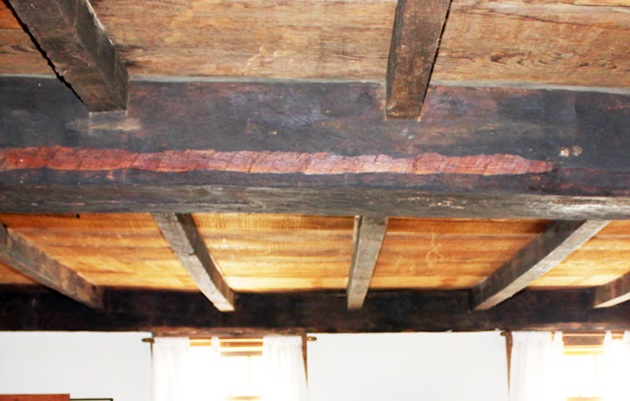 Massive summer beams carry the floor joists in the Thomas Dennis house