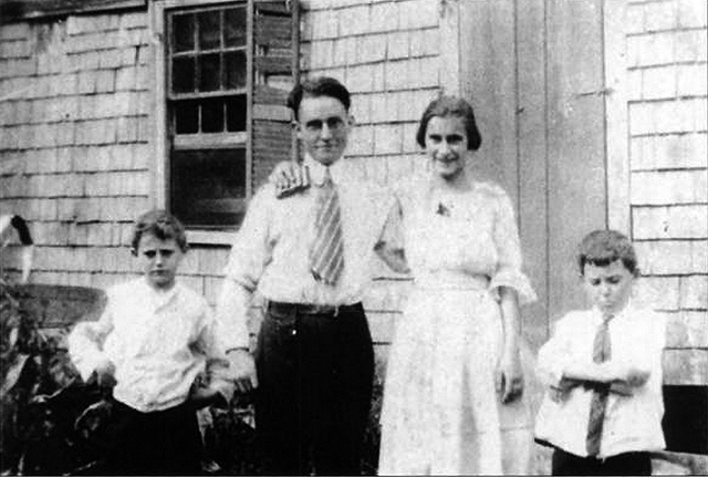 Harold Bowen (left), his parents and twin brother, in front of this house