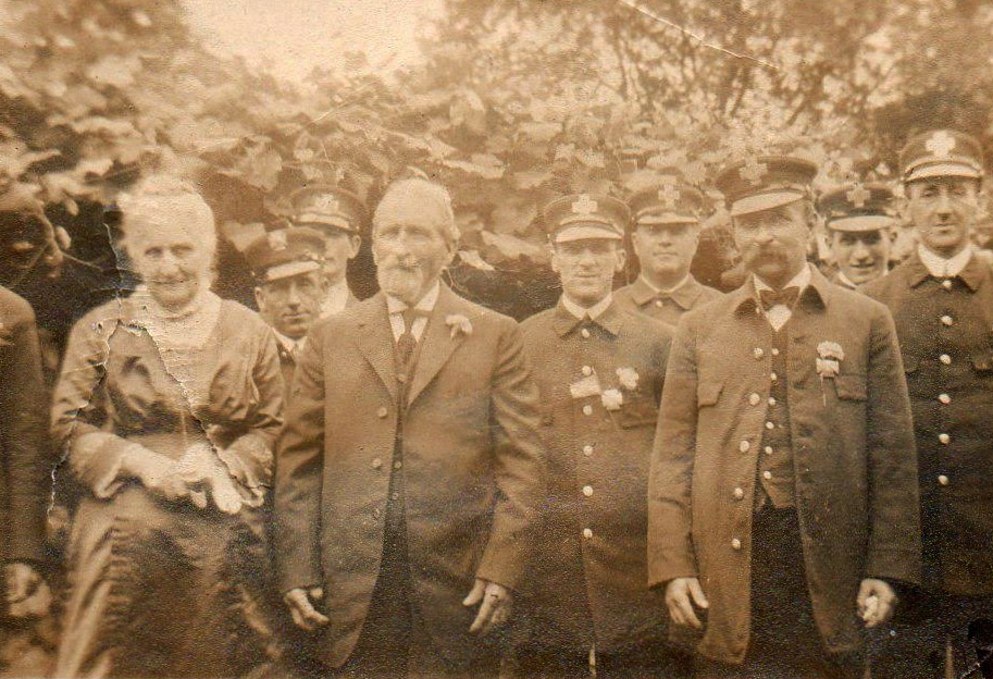 John Leander Gaudette and his wife Ida, who are believed to have lived in this house in the 1800's, standing with Ipswich firemen.