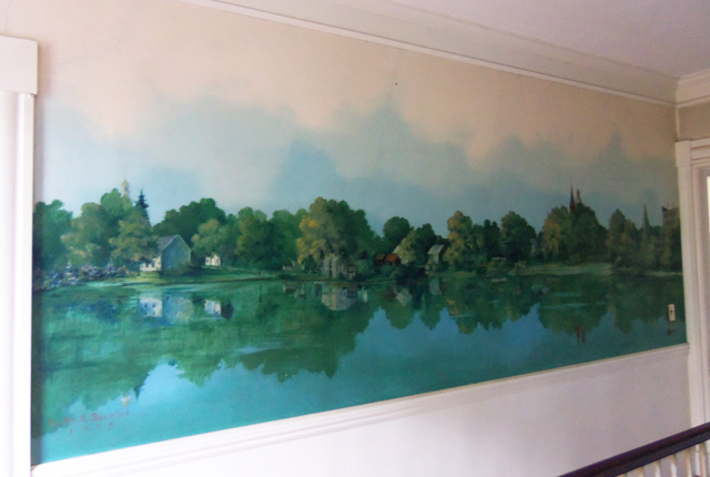 The mural continues in the upstairs hall and has the signature of the artist, from 1935.