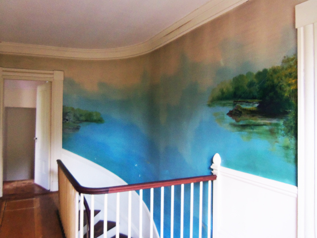 A mural painted in 1935 wraps the stairway and halls on both floors