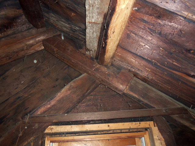 Attic framing shows where the roof was raised when the lean-to was added