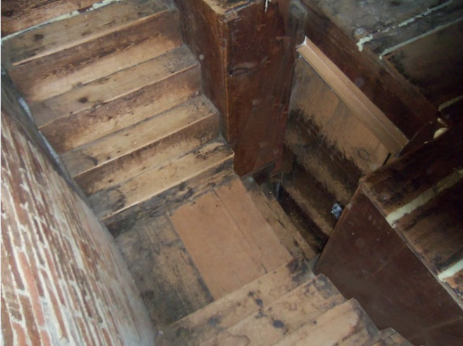 The William Caldwell house was home to two families,. The stairs to the attic split split after the entrance.
