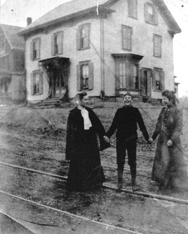 The wife and children of South Church pastor Rev. Thomas Franklin Waters, in front of this house at 96 County Road.