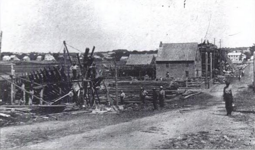 Ships being built along Main Street in Essex, 1872