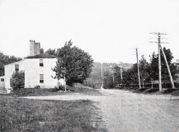 Topsfield toll house for the Newburyport Turnpike. In the distance the road rises over one of several hills.