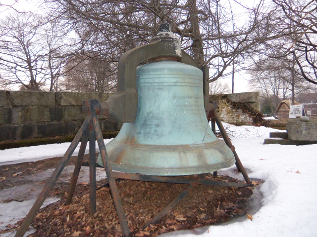 The  bell from the South Congregational Church stands in the foundation of the former South Congregational Church.