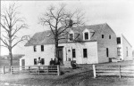 """Photograph of the Hart House taken in March,1886 by Edward Darling, from the collection of William J.Barton.  Mr. Barton identified the three people in the photo, """"all I knew well: <r/ {jo;o[ :prd Lo,ba;;. bprm Pctpber 22. 19839; Miss Lucy Ardell Kimball, born June 24, 1875; and Mrs. Kate Smith (Merrill) Kimball, born March 26, 1842."""""""
