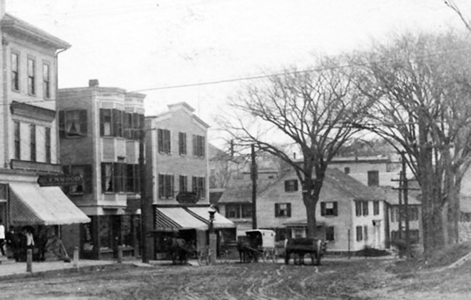 A closeup from the Damon Building photo shows the two small houses above.