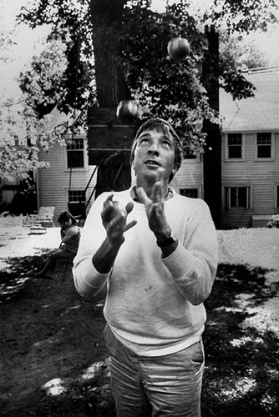 John Updike in the back yard of the Polly Dole house in Ipswich