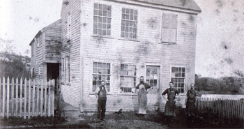 The Perkins and Daniels Shoe Shop started in this small house on Summer Street, shown above, which no longer stands.