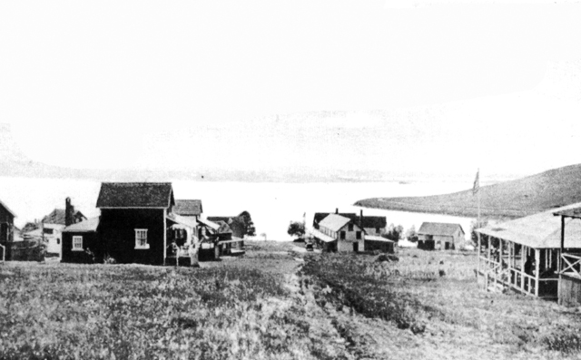 This early 20th Century photo shows cottages on Great Neck before many streets were laid out. On the right is the tip of Little Neck, still uninhabited, and the coastline in the distance is Annisquam.