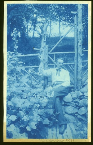 Dow posing on stone wall cyanotype by Arthur Wesley Dow