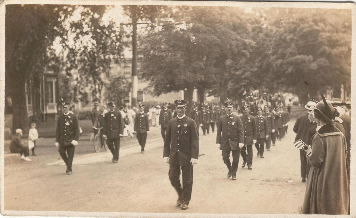 Early 20th Century Ipswich parade with firemen marching