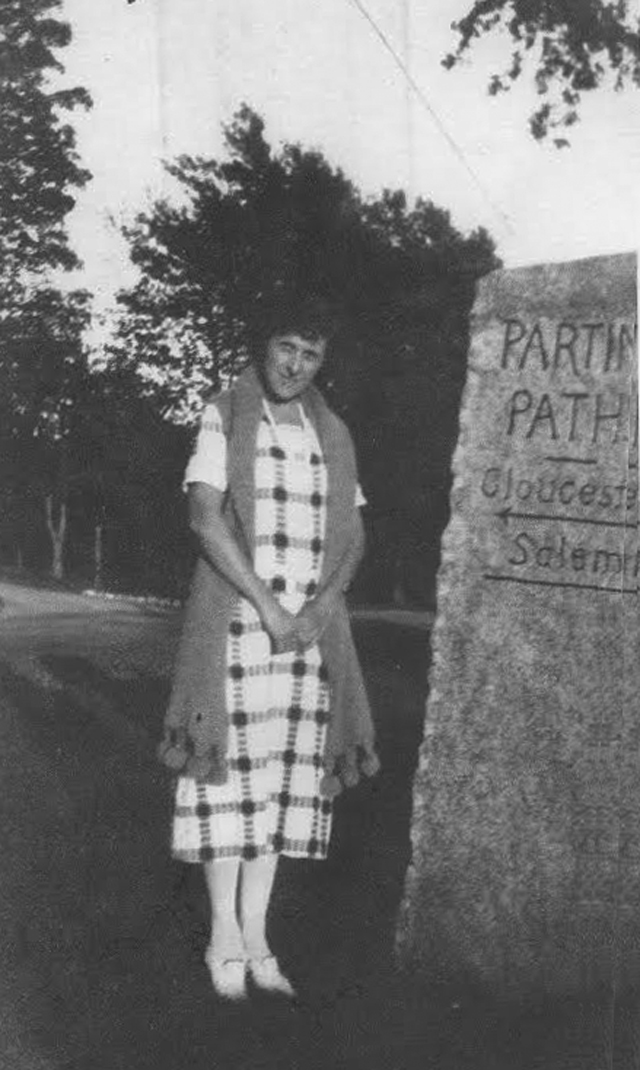 "The intersection of Rt. 133 and 1A (Where Essex Road branches off from Bay Road/County Road) was for many years called ""Parting Paths"". This stone marked the intersection, but neither the location of the stone or the identity of the woman in the photo is known."
