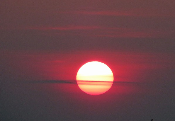 Cory Simons took this sunset photo on July 25, 2014 as smoke from wildfires in western Canada drifted over New England