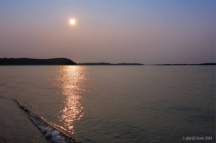 David Stone took this late day photo on July 25, 2014. The brownish color is from smoke drifting eastward from Canadian wildfires.