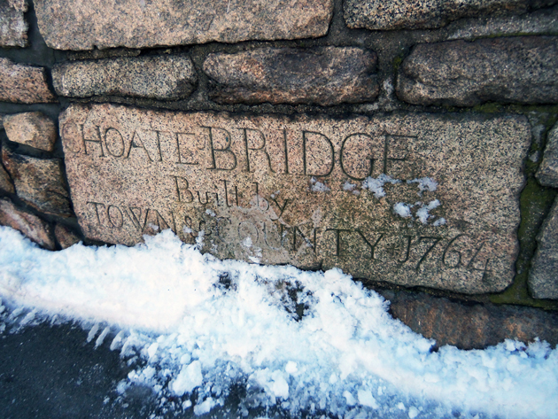 This inscription is on southwest side of the bridge, close to the first building on South Main Street