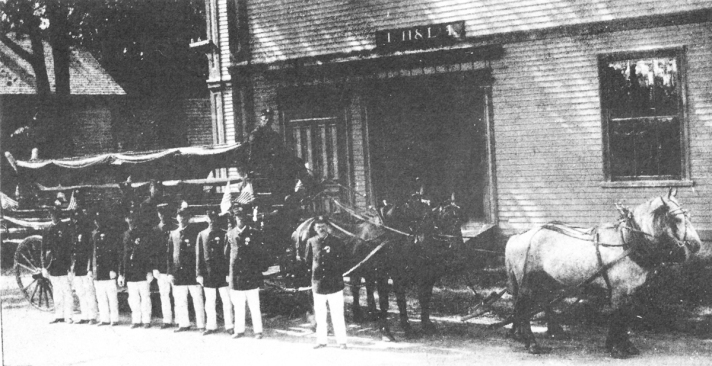 Hook and Ladder 1, on which George Gilmore was killed on June 28, 1906. Crew includes Ernest Carter (left), Whalen Waite, Ed Poole, Walter Poole, Thomas Roberts, Raymond Dodge, Arthur Norwood, Alfred Barton, Alfred Waite, George gilmore (rear left), Mr. Clarke and George Brown. The driver is Oscal Littlefield (Photo courtesy of Mrs. Gertrude Manthorne and Harold Bowen)