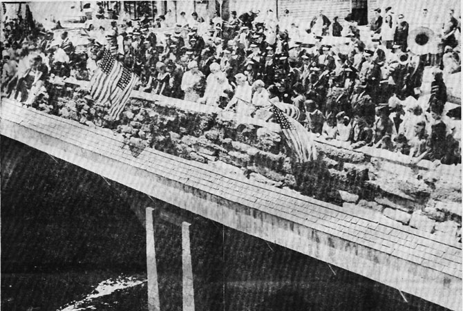 The 1967 Memorial Day parade. Members of the Ipswich Women's Relief Corps cast wreaths of flowers into the Ipswich River in remembrance.