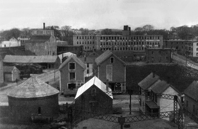 The silo is in the upper left corner in this old photo, with the Burke Heel Factory in the background.