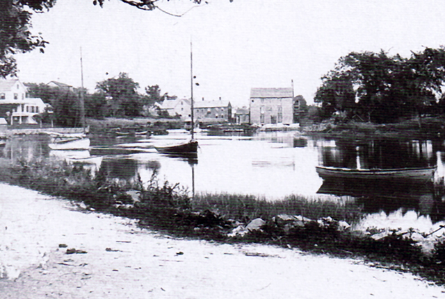 The Wirthmore Feeds grain elevator was originally located at Choate's Wharf, and was moved through town to Brown Square to become Chaplin's grain storage.