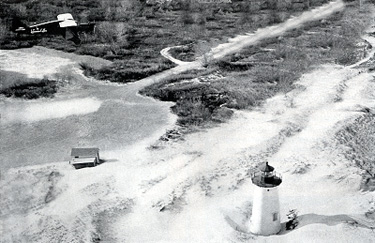 Aerial view of the Flying Santa approaching the Ipswich Lighthouse