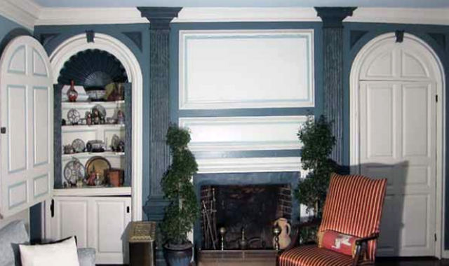 n the front parlor of the Captain Richard Rogers House, Ipswich, c. 1728, Abraham Knowlton's fireplace wall is the earliest example of Georgian interior design in Ipswich, and one of the earliest in America. Its studied symmetry, its stop-fluted classical pilasters with elaborate capitals and its raised panels were strikingly in advance of the walls sheathed with vertical, edge-molded boards of the first period houses (1635-1725) that preceded it (and that were still being built.