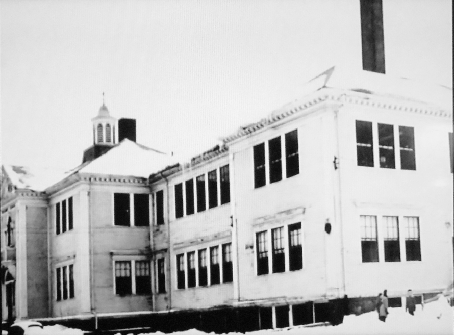Winthrop School with the addition on the south side. Above the roof, you can see the tower on top of Manning School