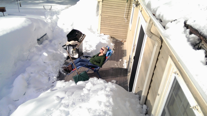 Meanwhile, Deb tackled the snow on the rear deck, and then took in a bit of sun in our backyard snow fort.
