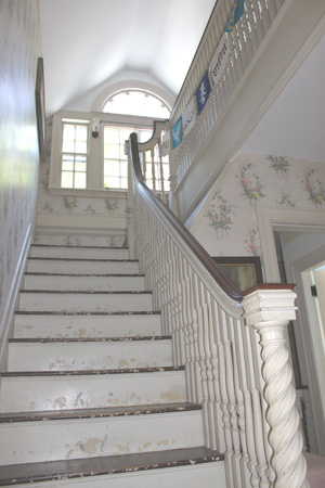 Stairs and balustrade at the Old Manse, House of Peace in Ipswich
