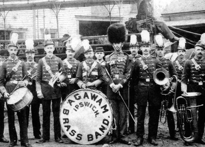 The Agawam Brass Band with a horse-drawn trolley behind it. Photo courtesy of the Barton collection, Ipswich Museum