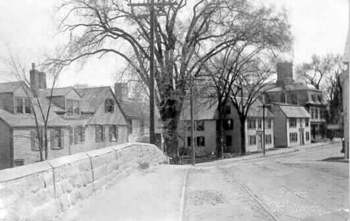 This photo from the turn of the 20th Century shows the trolley tracks. The house on the left was moved to the Wendell estate on Jeffreys Neck Road.