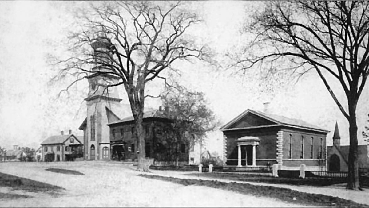 the Nathaniel Wait house, the Methodist Church, Odd Fellows Building, Ipswich Public Library, and the Ascension Church visible behind the Library.