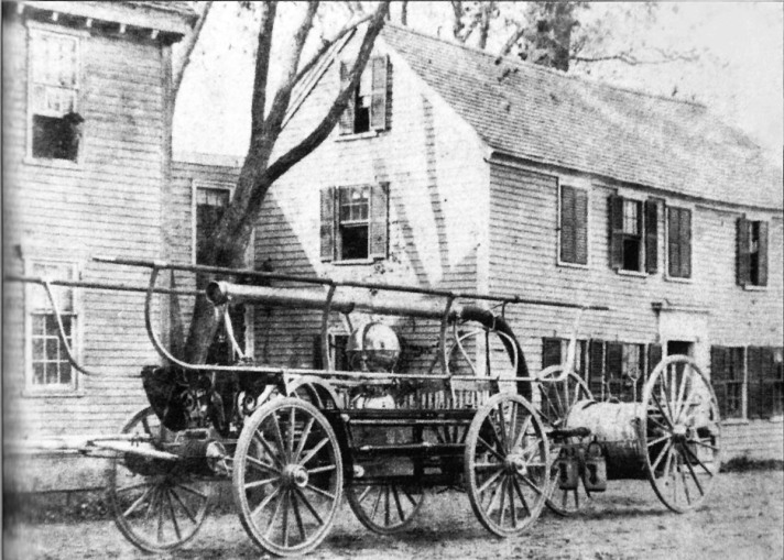 The Warren hand pump fire truck, sitting near the corner of Warren and North Main Streets
