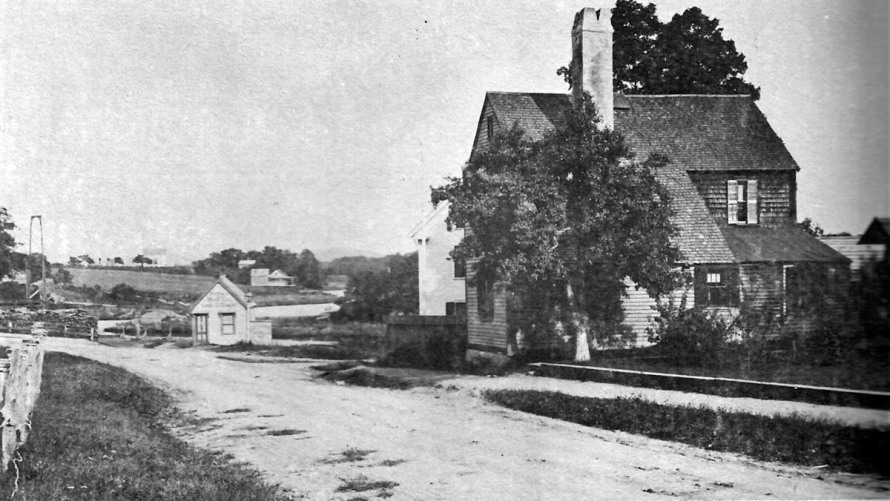 Water St. at Town Wharf. The small building on the right may have been the old Customs House.