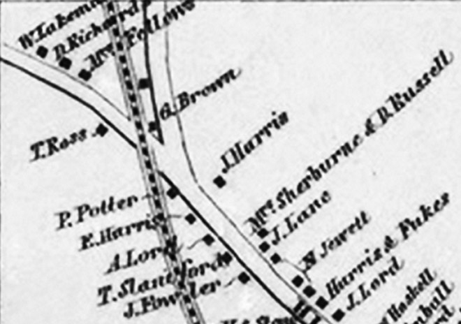 A section of the 1856 Ipswich village map, showing the  intersection of High St. and Town Farm Rd. The Dow-Harris house is on the left, and a small building sits in the intersection, owned by