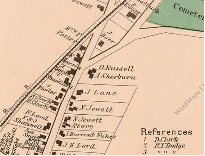 The intersection of High St. and Town Farm Rd., 1872. The Dow-Harris house is indicated on the left, and a small building is shown in the intersection with Town Farm Rd.