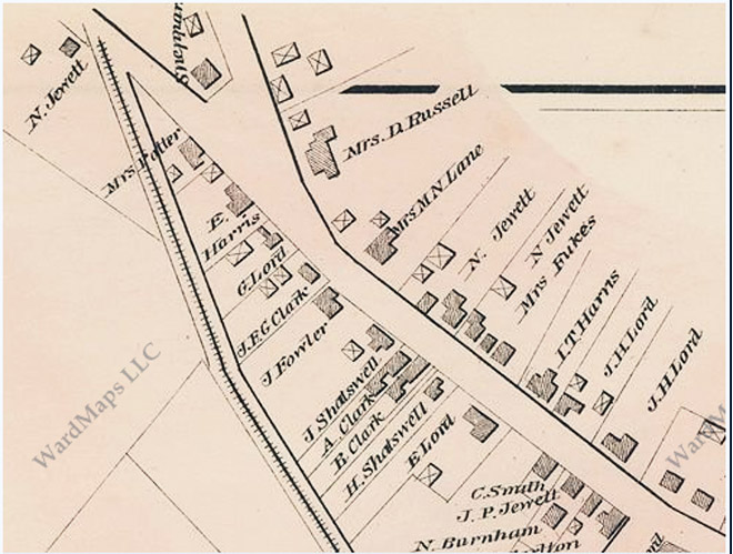 The 1884 map shows a  barn or shed (indicated by an X) beside the Dow-Harris house in the same position as the photo of the children.