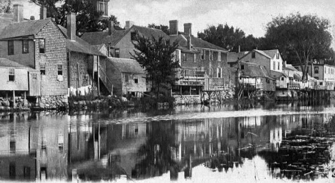 Houses and shops were built down to the low water mark on the Ipswich River, giving it the nickname,