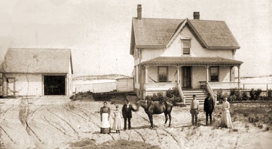 Benjamin Ellsworth with family members in front of the lightkeeper's house. Photo courtesy of Melissa Berry