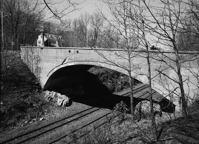 Cooper Street Bridge is significant as a very early example of reinforced concrete arch construction, notable for its substantial size, asymmetrical profile, and use of an unusual type of deformed rod for reinforcement. It is one of only two concrete-arch bridges of its age spanning more than 50' that are known to survive in Massachusetts. Although the designer of the bridge is unknown, the contractor, Joseph Ross, was one of Boston's leading builders of wharves and bridges.