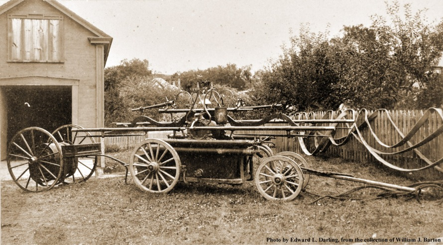 The Barnicoat handtub in front of the first Warren engine house, rear of the larger Warren Engine houseand Hose No. 1, and Masconnomet le France Steam fire engine.