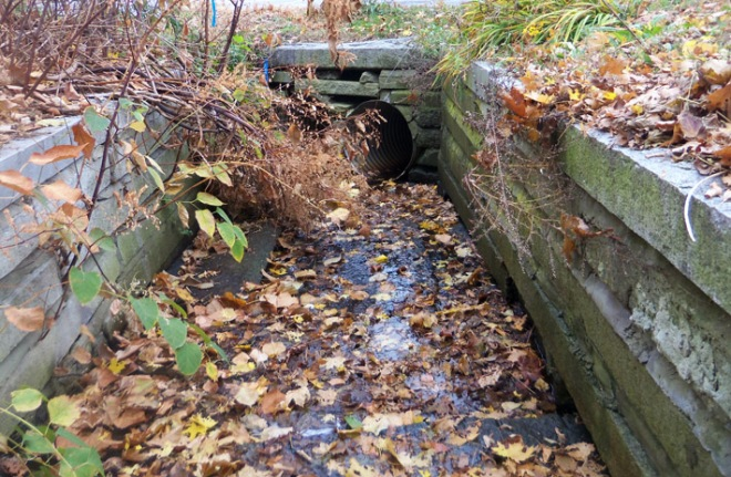 Farley Brook goes underground behind the laundromat on Central Street