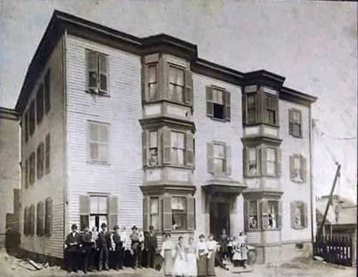 """The Dugway family in front of the """"French Block"""" in 1906. Photo courtesy of Deric Marcorelle"""