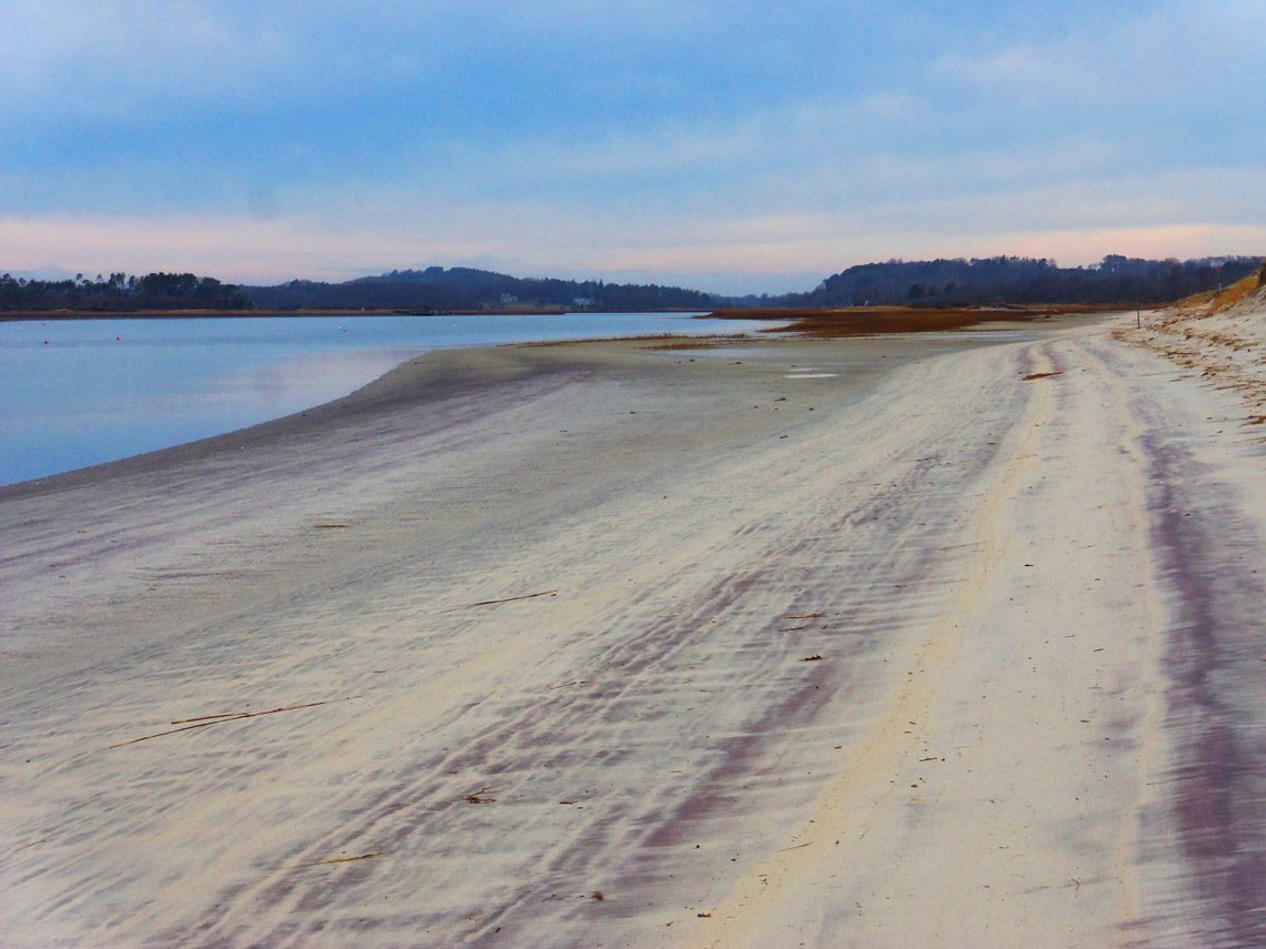 Why does Crane Beach have purple sand?