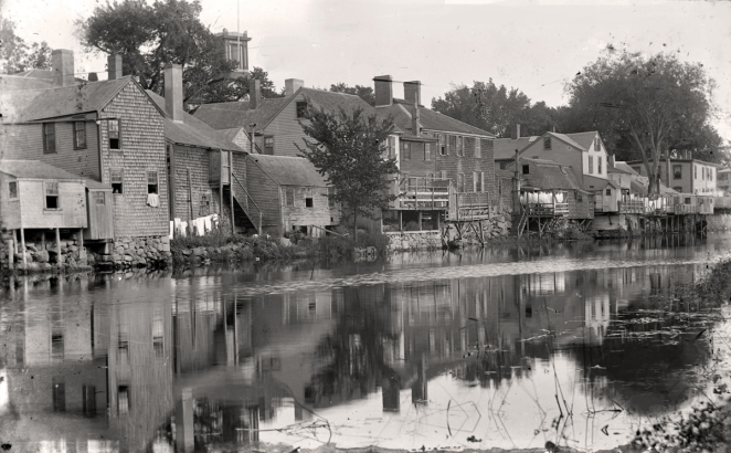 A view of the rear of the buildings on South Main Street, just below the dam was known as